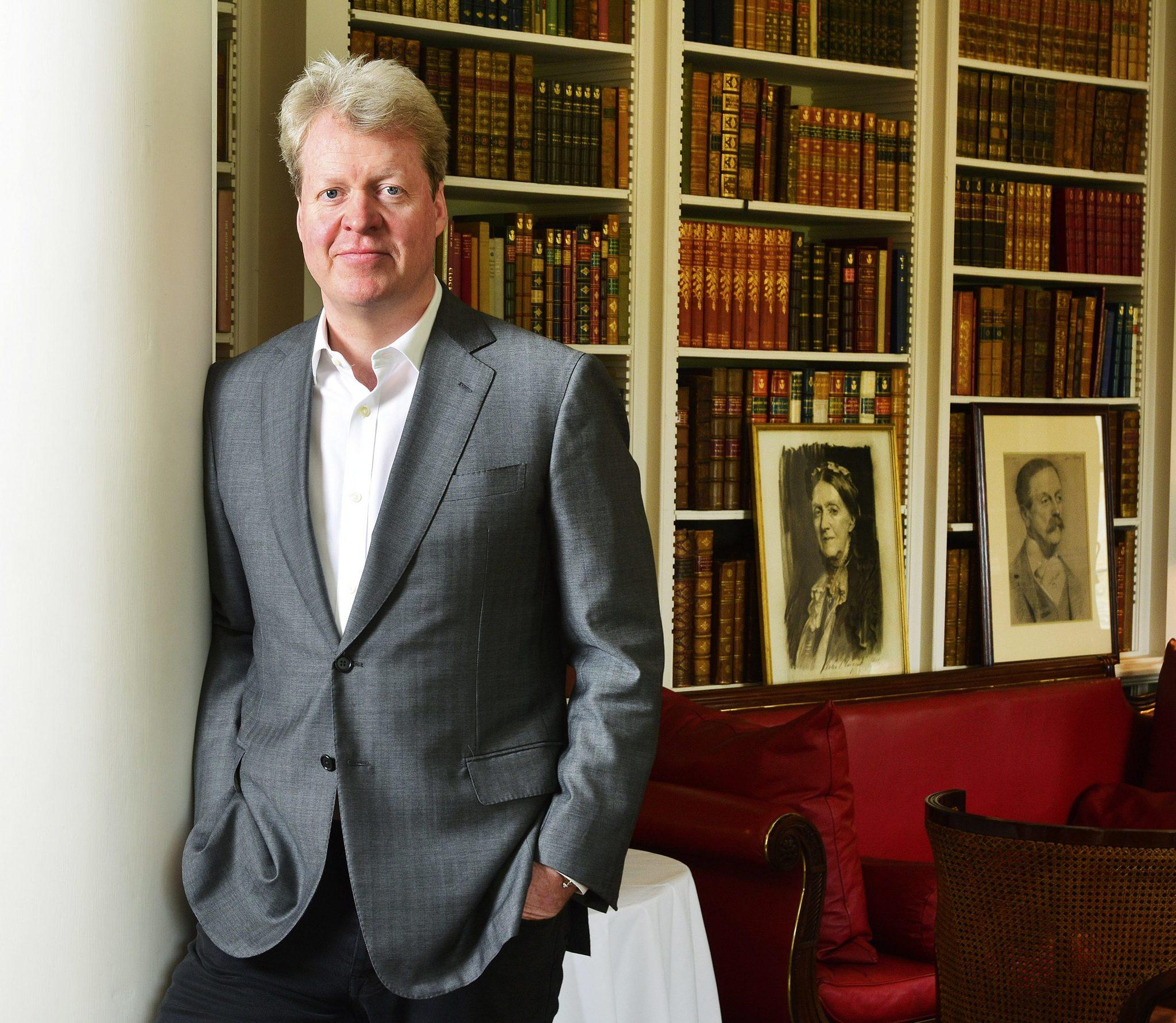 Charles Spencer, 9th Earl Spencer, in the library at Althorp, Northamptonshire, 15th May, 2014. Photo by John Robertson, ©2014.